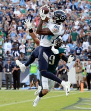 Tennessee Titans wide receiver Corey Davis (84) catches the winning touchdown pass over Philadelphia Eagles cornerback Avonte Maddox (29) in overtime of an NFL football game Sunday, Sept. 30, 2018, in Nashville, Tenn. The Titans won 26-23. (AP Photo/Mark Zaleski)