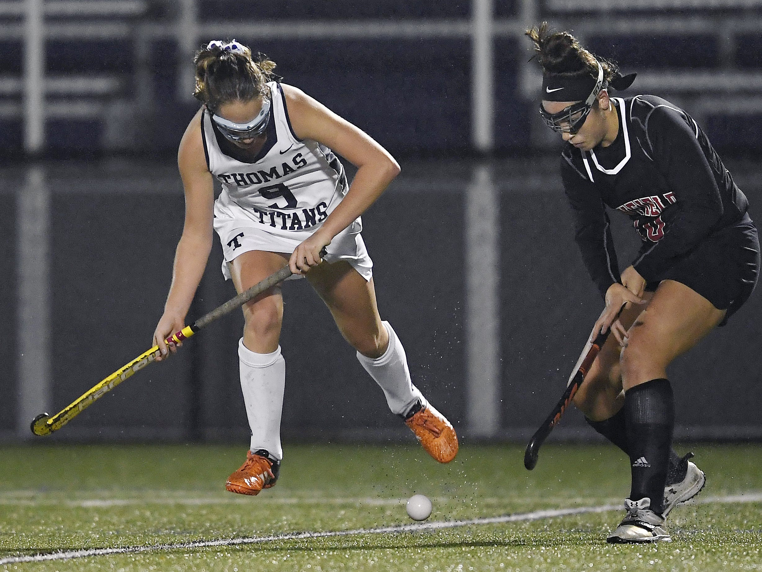 Webster Thomas' Jenna Parrish, left, and Penfield's Jessica Rinere vie for the ball during a regular season game played at Webster Thomas High School, Monday, Oct. 1, 2018. Penfield beat Webster Thomas in overtime 2-1.