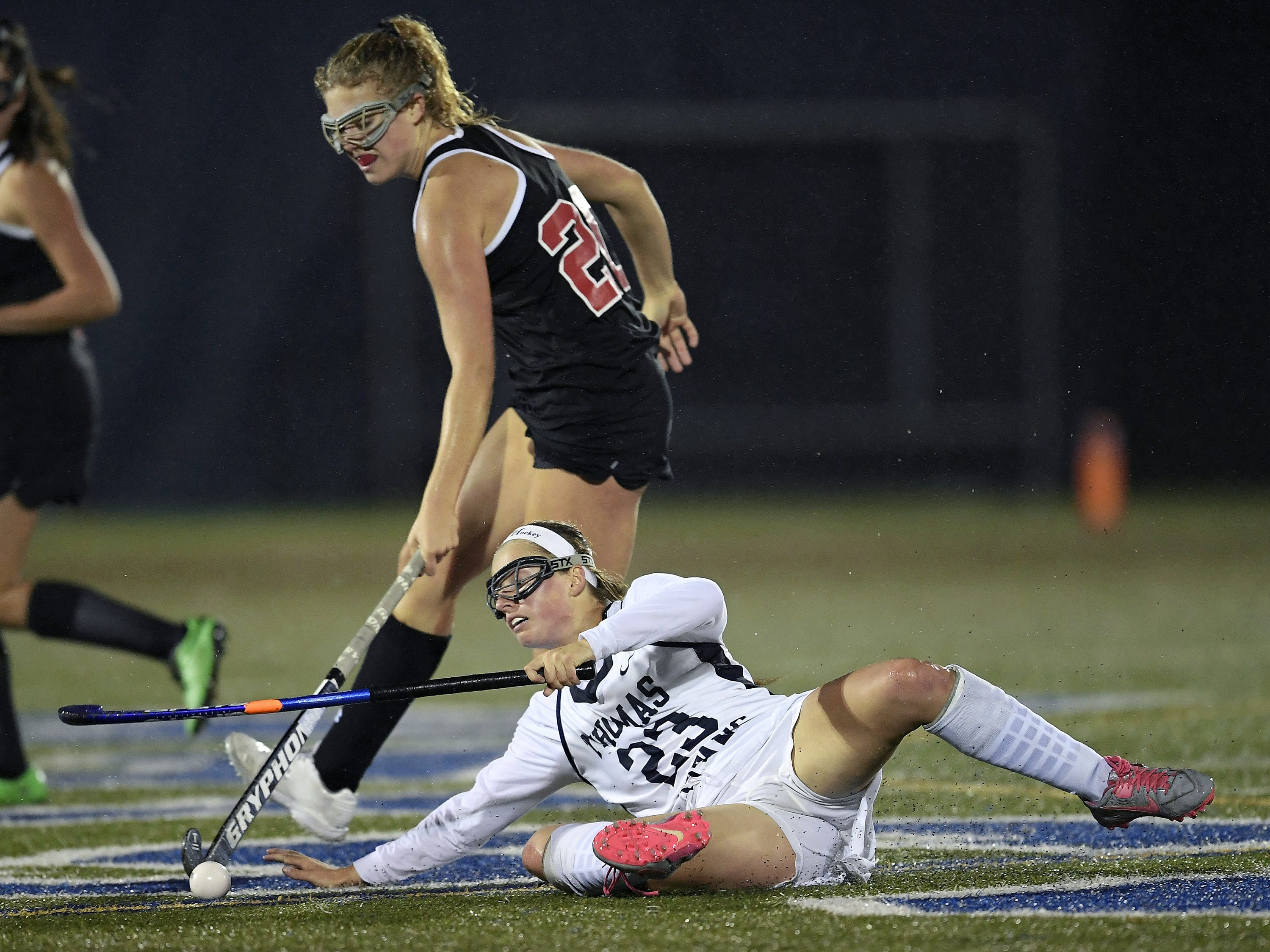 Webster Thomas' Victoria Vahl, bottom, goes to ground while defended by Penfield's Hope Wilder during a regular season game played at Webster Thomas High School, Monday, Oct. 1, 2018. Penfield beat Webster Thomas in overtime 2-1.