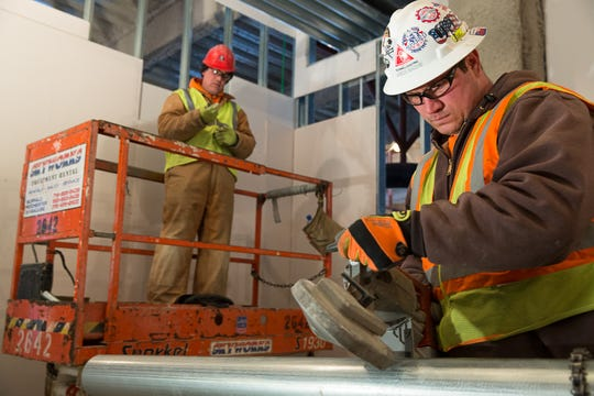 O'Connell Electric employees work on a 2014 project at Golisano Children's Hospital.