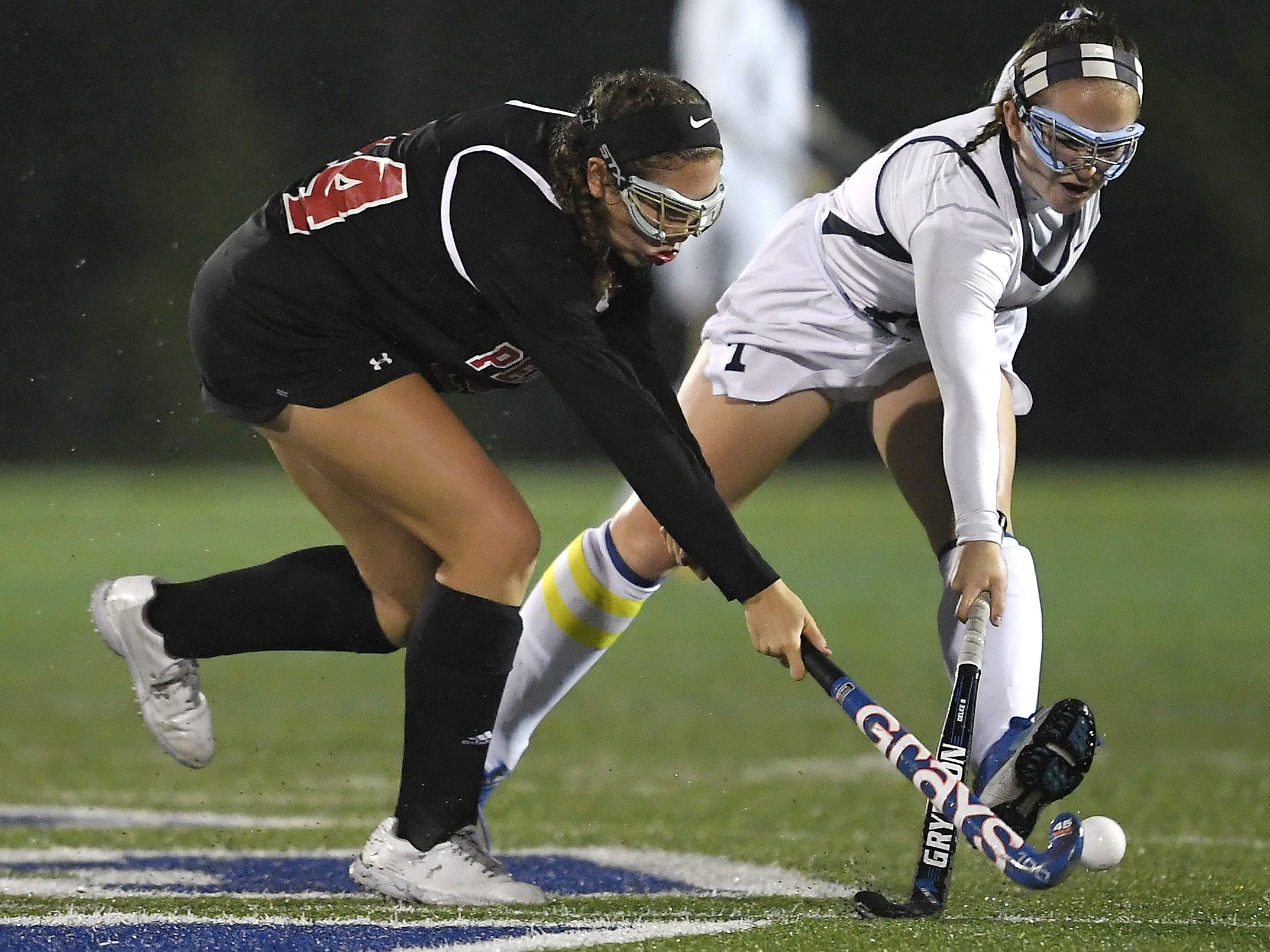 Penfield's Katherine Rinere, left, and Webster Thomas' Leeanna Caruso reach for the ball during a regular season game played at Webster Thomas High School, Monday, Oct. 1, 2018. Penfield beat Webster Thomas in overtime 2-1.