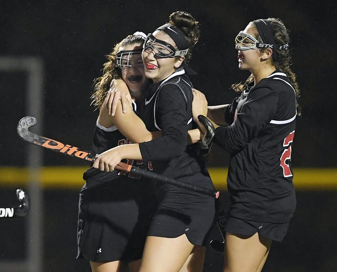 Penfield's Jessica Rinere, center, celebrates the Patriot's game-winning goal with teammates Lindsey Hamilton, left, and Katherine Rinere during a regular season game played at Webster Thomas High School, Monday, Oct. 1, 2018. Penfield beat Webster Thomas in overtime 2-1.