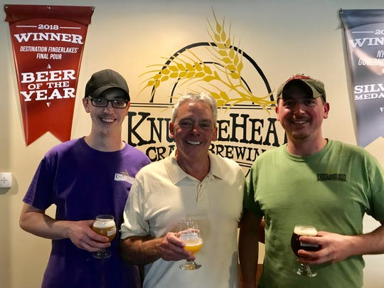 Josh, left, Len, center, and Jake Dummer, the owners of Knucklehead Craft Brewing in Webster.