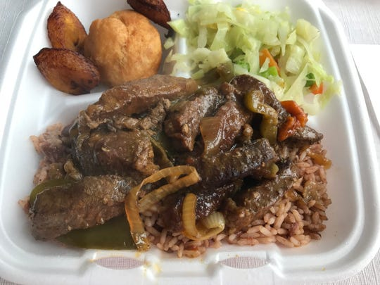 A to-go order of Peppa Beef comes with steamed vegetables, plantains, rice and beans and a dumplin.