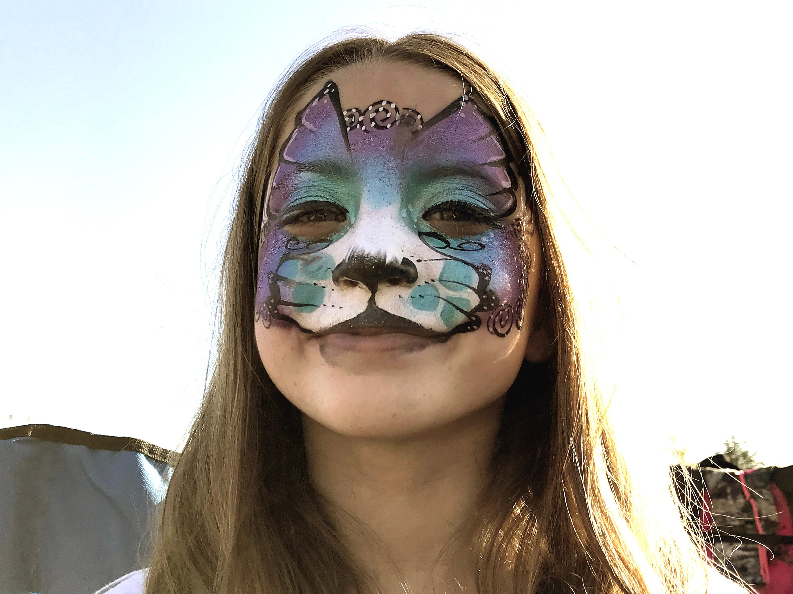 Bailey Lowdermilk, 9, of Redding wears a Merkitty face at the Redd Sunn Festival on Sunday.