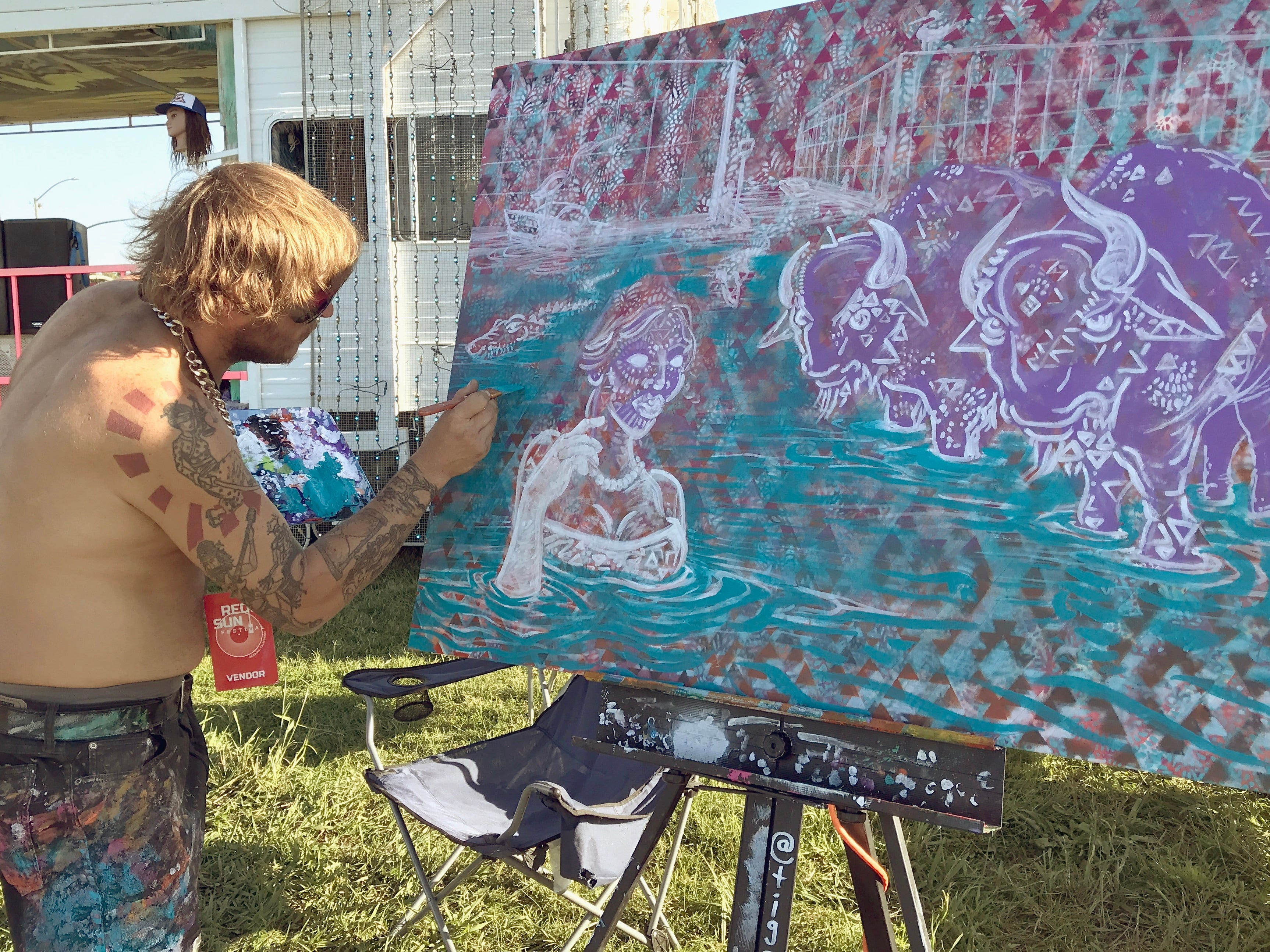 Artist Dan Buell, aka Tigerider, creates a painting Sunday afternoon at the Redd Sun Festival.