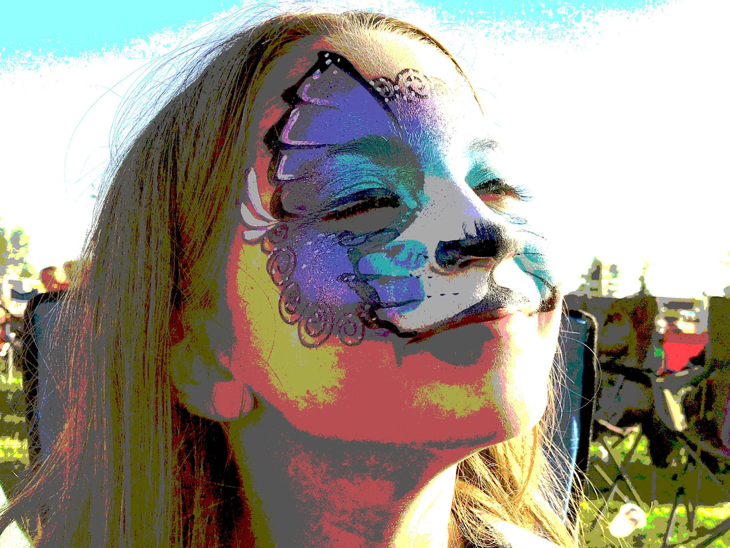 Bailey Lowdermilk, 9, of Redding wears a Merkitty face at the Redd Sunn Festival on Sunday in this postereized image.