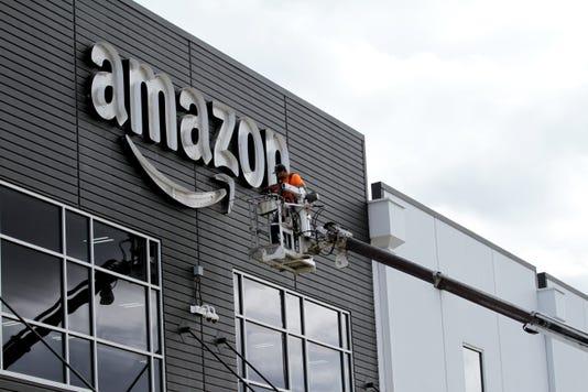 MAIN-Amazon Raises Minumum Wage Mr02