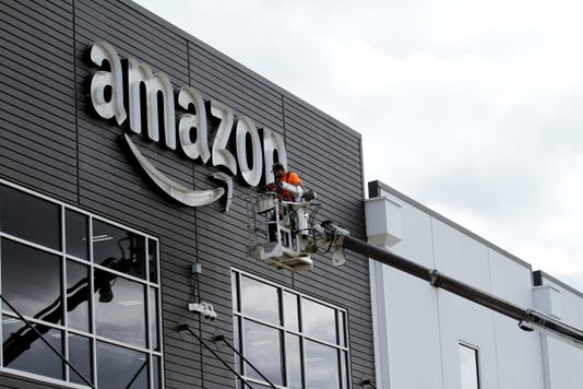 MAIN-Amazon Raises Minumum Wage Mr02