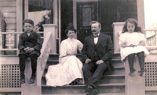 The Wenger family of Salem sits on the porch of their home on Water Street NE in the early 1900s. From left to right: Son Karl, Mom Alice, Dad Jacob, and Daughter Trista.
