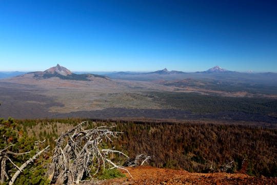 Views of Mount Washington, Three Fingered Jack, Mount Jefferson and Mount Hood from the top of Black Crater west of Sisters.