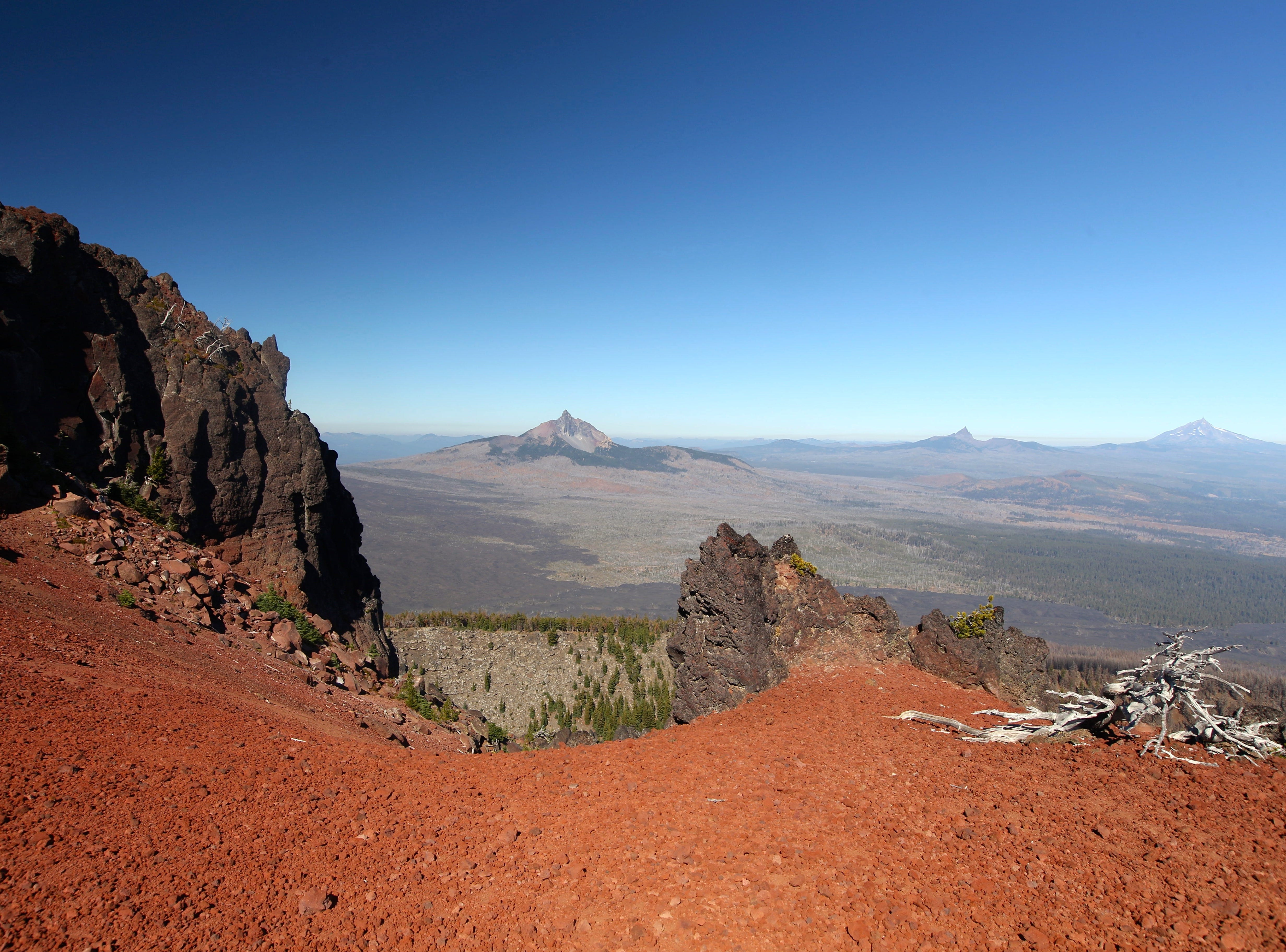 View of Cascade peaks from the top of Black Crater west of Sisters.