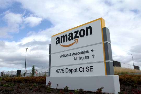The Amazon packing and shipping center in southeast Salem opens in August, a company spokeswoman said.