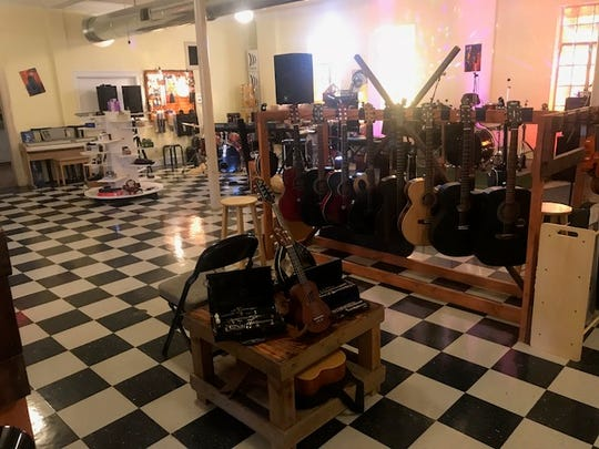 Instruments are displayed for sale at BackBeat Music Company.