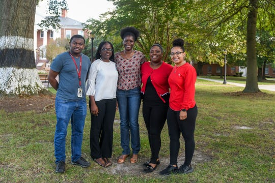University of Maryland Eastern Shore students Jason Bowie, Barakat Adebola Owolabi, Sherene Black and Taylor Robinson-Brown (left to right) pose with professor Tracy Bell (center) on campus on Tuesday, Oct 2, 2018.