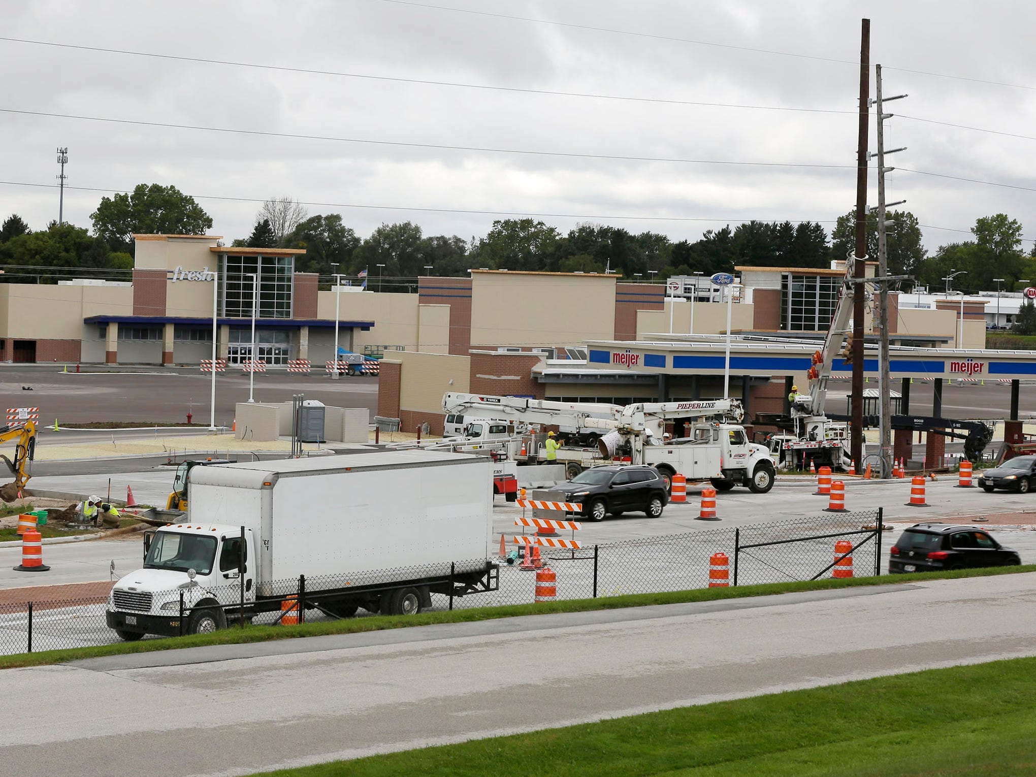The Meijer store under construction where a majority of Memorial Mall used to be is a beehive of activity with trucks and construction gathered around work areas, Tuesday, October 2, 2018, in Sheboygan, Wis.