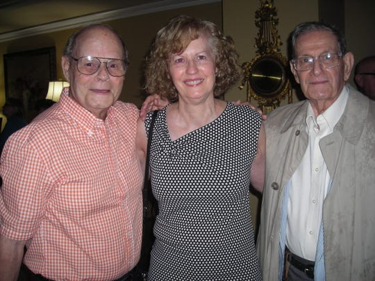 Former Times staffers at Elane Troquille Tebow's 90th birthday gathering: Photographer Lloyd Stilley, Features Ed Kathie Rowell, Managing Ed Allan Lazarus.