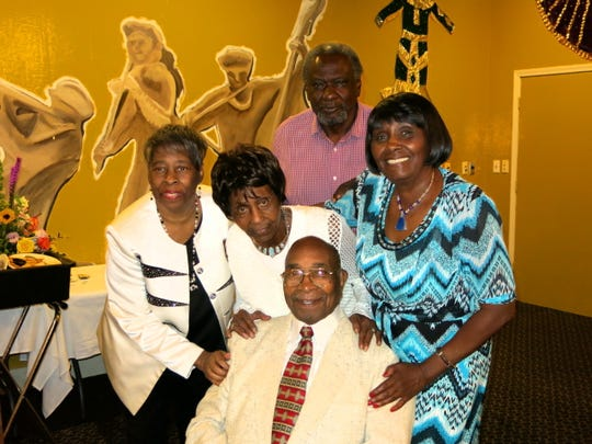 Honoree Alex Harris III (clockwise, from seated) Doris Elie, Annie Smith, Louis Elie, Gloria Mitchell at birthday dinner.