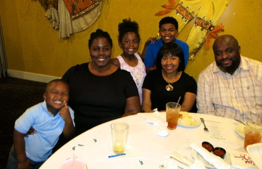 Josiah Shaw, Arlena Harris, Sydni Jones, Caleb Carter, Teryn Stevenson, LeKelvie Heard at Alex Harris Sr.'s birthday dinner. Paul Schuetze/The Times
