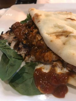Grilled jerk chicken with tikka masala sauce on naan at The Attic/Ass'ociates.