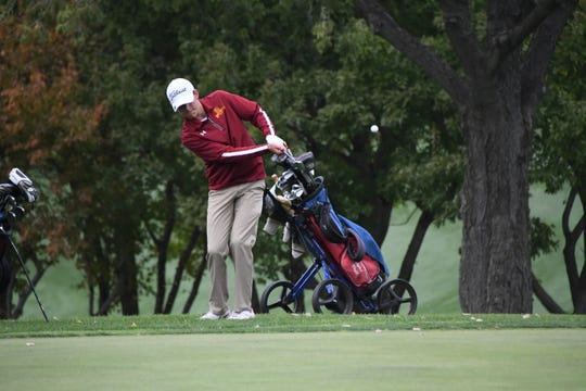 Roosevelt's Jack Lundin chips onto the green at No. 17 during the second round of the Class AA boys state golf tournament on Tuesday at Brookings Country Club.