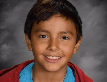 Mateo Cooley, 10, was last seen Saturday in Rose Creek, Minnesota. A warrant is out for the arrest of his mother, Izetta Cooley, the wife of a man accused of murder in Fargo, North Dakota.