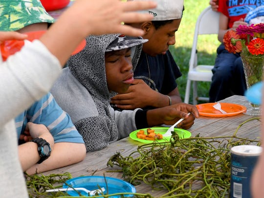 Students sample sweet potatoes at Virginia School for the Deaf and Blind's educational urban farm on Monday, Oct. 02, 2018.