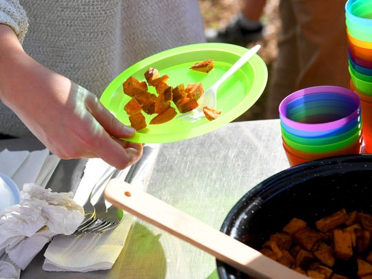 A plate of cooked sweet potatoes are spooned onto a plate for a student to sample at Virginia School for the Deaf and Blind's educational urban farm on Monday, Oct. 02, 2018.