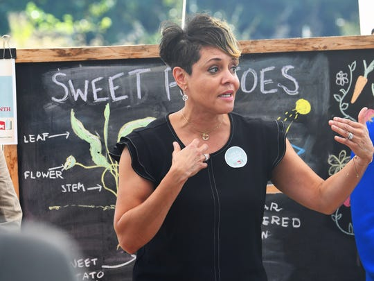 Commissioner Jewel H. Bronaugh of the Virginia Department of Agriculture and Consumer Services speaks to students in a class at Virginia School for the Deaf and Blind's educational urban farm on Monday, Oct. 02, 2018.