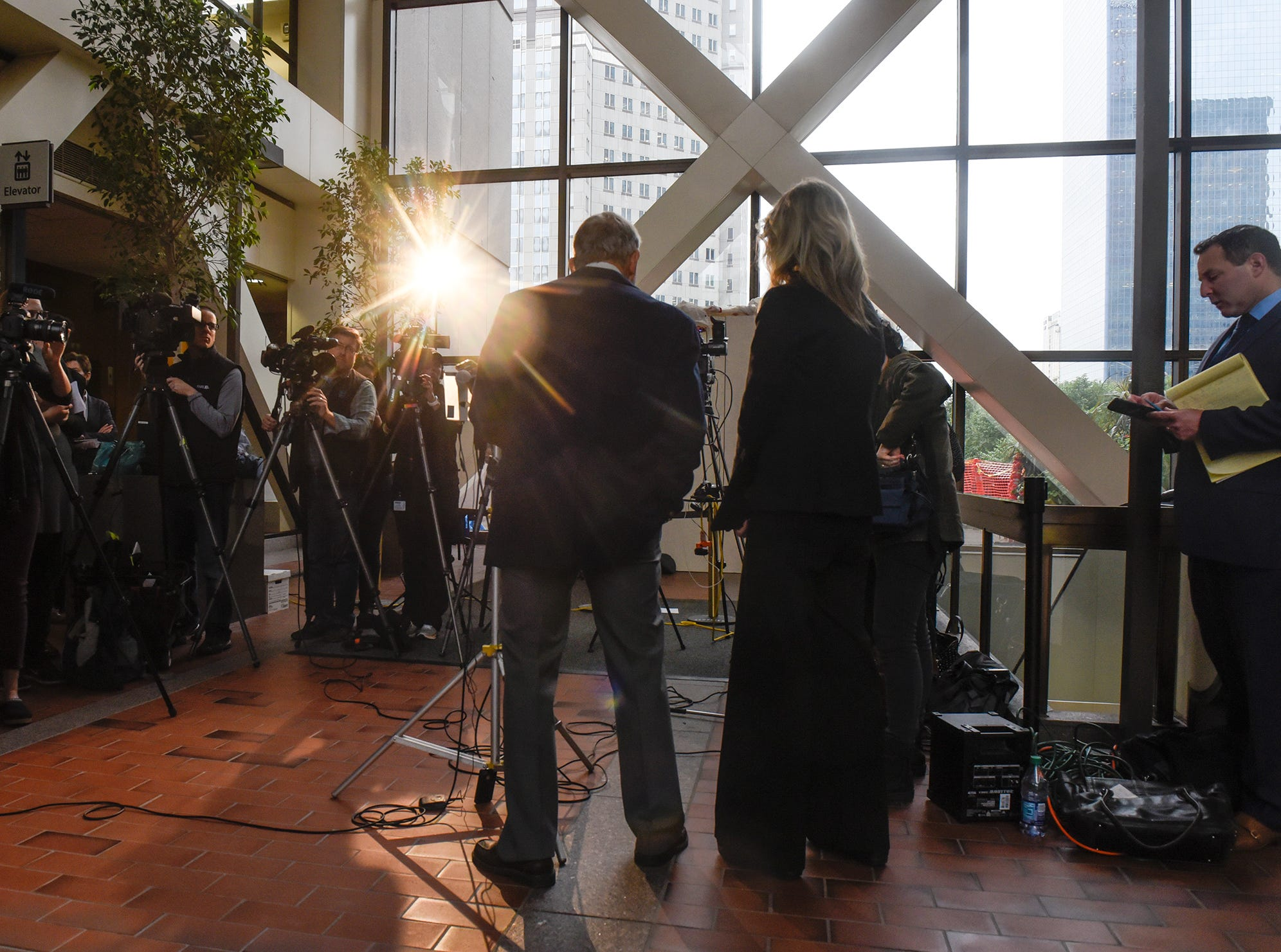 Media crews surround retired FBI agent Steve Gilkerson as he speaks during a press conference Tuesday, Oct. 2, at the Hennepin County Government Center in Minneapolis.