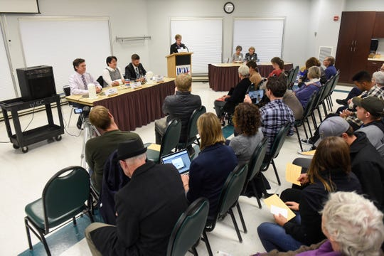 People gather Monday, Oct. 1, for the League of Women Voters House 14A and 14B debate in St. Cloud.
