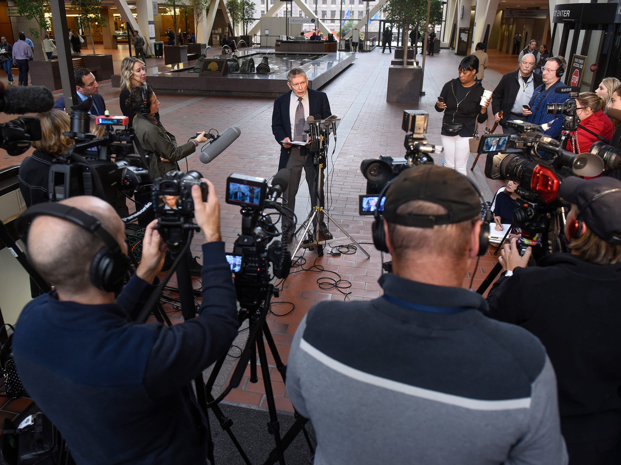 Former FBI agent Steve Gilkerson is surrounded by media members during a press conference Tuesday, Oct. 2, at the Hennepin County Government Center in Minneapolis.