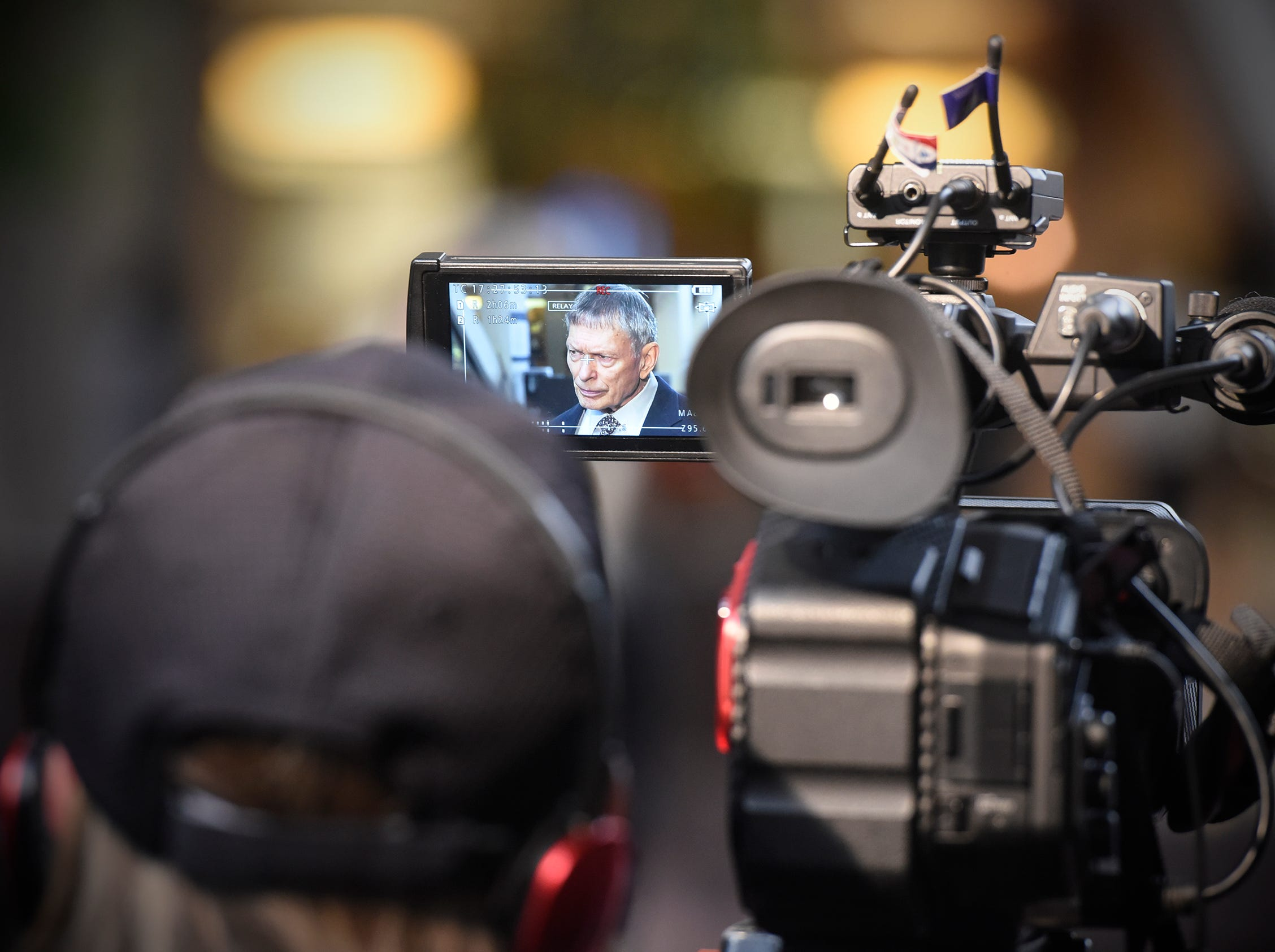 Camera crews record as Former FBI agent Steve Gilkerson answers questions during a press conference Tuesday, Oct. 2, at the Hennepin County Government Center in Minneapolis.