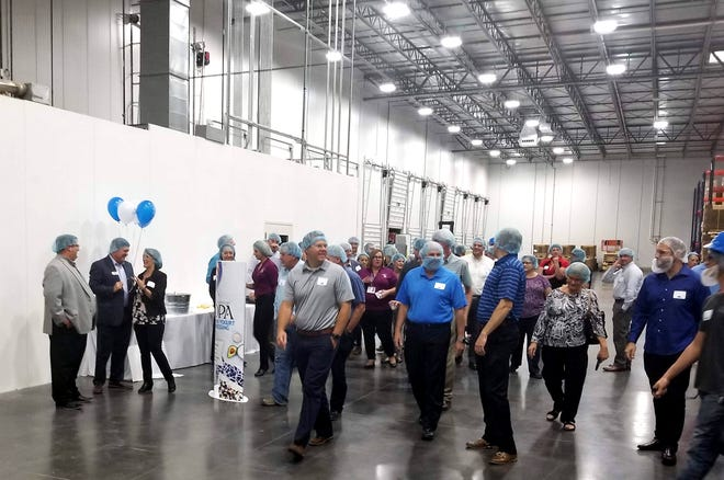 The Litehouse executive team and local employees take guests on a tour of the newly expanded Litehouse manufacturing facility in Hurricane, Utah on Wednesday, Sept. 19, 2018. The plant expansion and increased production capabilities are expected to create up to 165 future jobs.