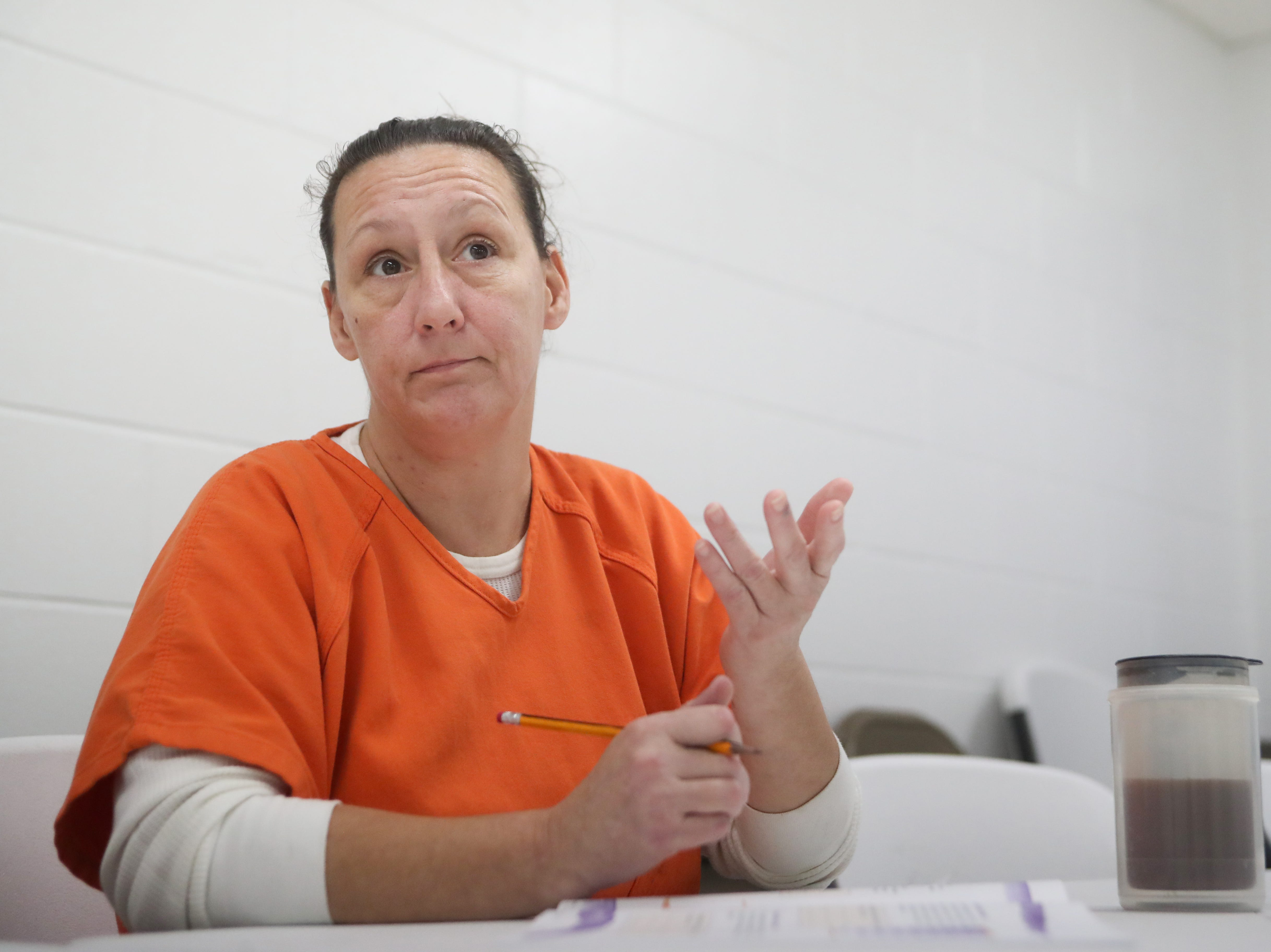 Tonya Seamon, an inmate at the Franklin County Jail, shares her experiences during a substance abuse counseling class by DISC Village at the jail in Eastpoint, Fla. Thursday, Oct. 27, 2018.