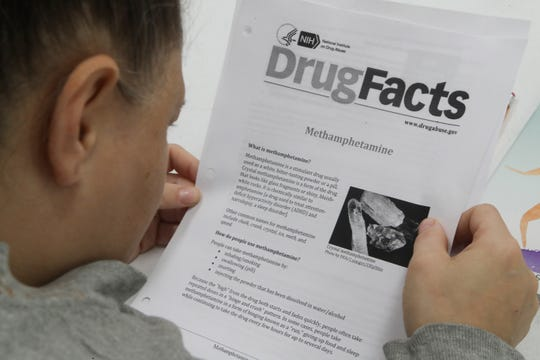 An inmate at the Franklin County Jail, reads about methamphetamine during a substance abuse counseling class by DISC Village at the jail in Eastpoint.