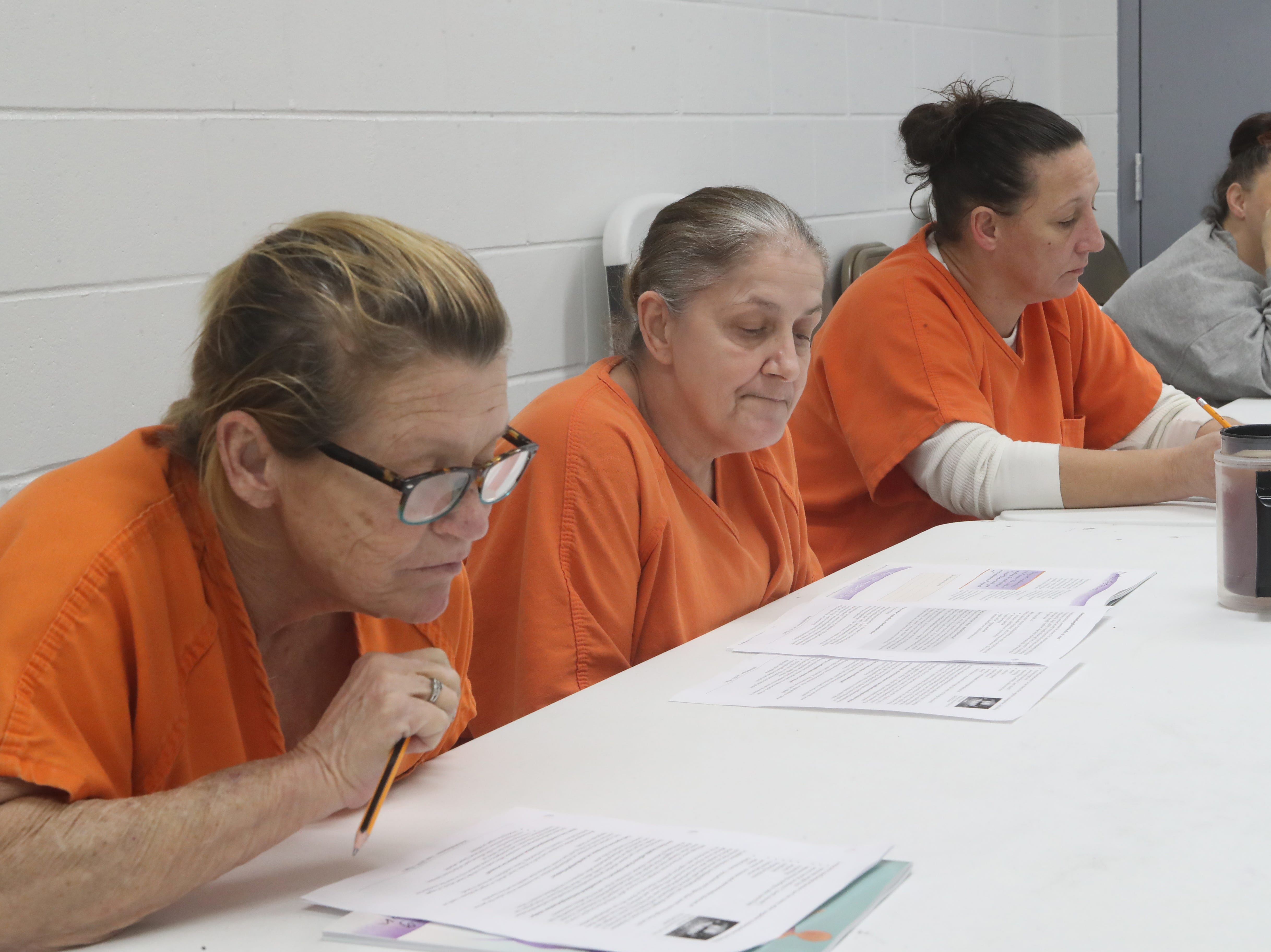Donna Needer, Tina Davis, Tonya Seamon and Amy Anderson, inmates at the Franklin County Jail listen during a substance abuse counseling class by DISC Village at the jail in Eastpoint, Fla. Thursday, Oct. 27, 2018.