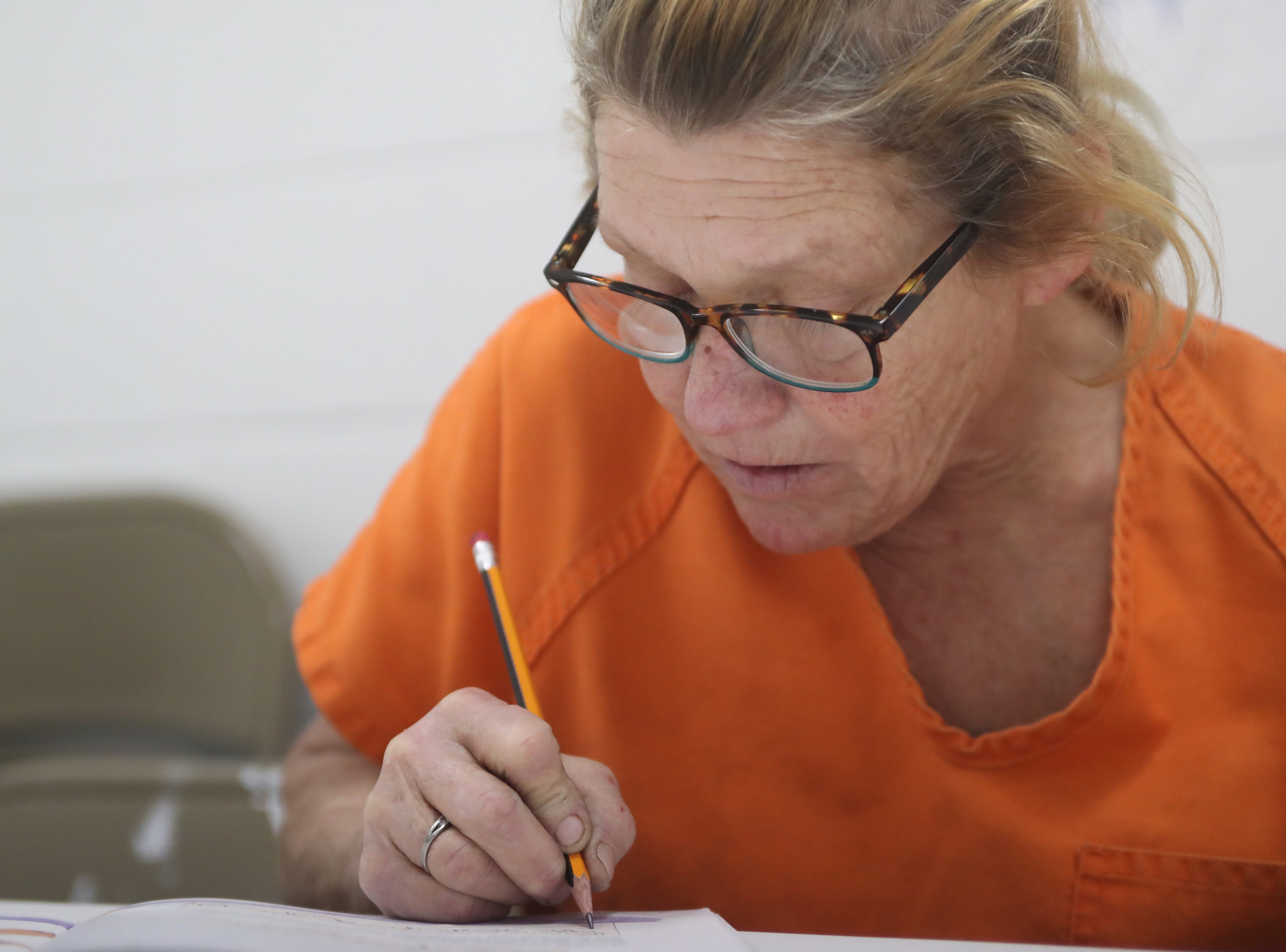 Donna Needer, an inmate at the Franklin County Jail, shares her experiences during a substance abuse counseling class by DISC Village at the jail in Eastpoint, Fla. Thursday, Oct. 27, 2018.