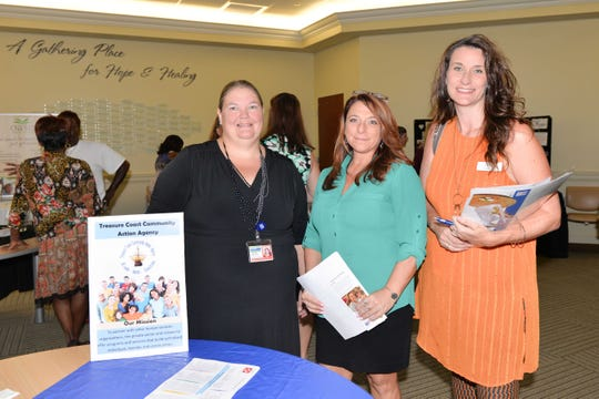 Tracy Jahn, left, of St. Lucie County Community Services, Doreen Roma of Families of the Treasure Coast and Kim Reid of Roundtable St. Lucie at the Showcase of Services at the Treasure Health Community Center in Fort Pierce.