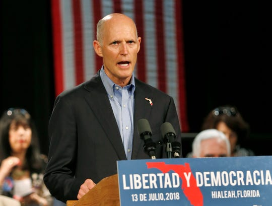 In this July 13, 2018, file photo, Florida Gov. Rick Scott speaks to Cuban-American supporters at a campaign stop, in Hialeah, Fla.