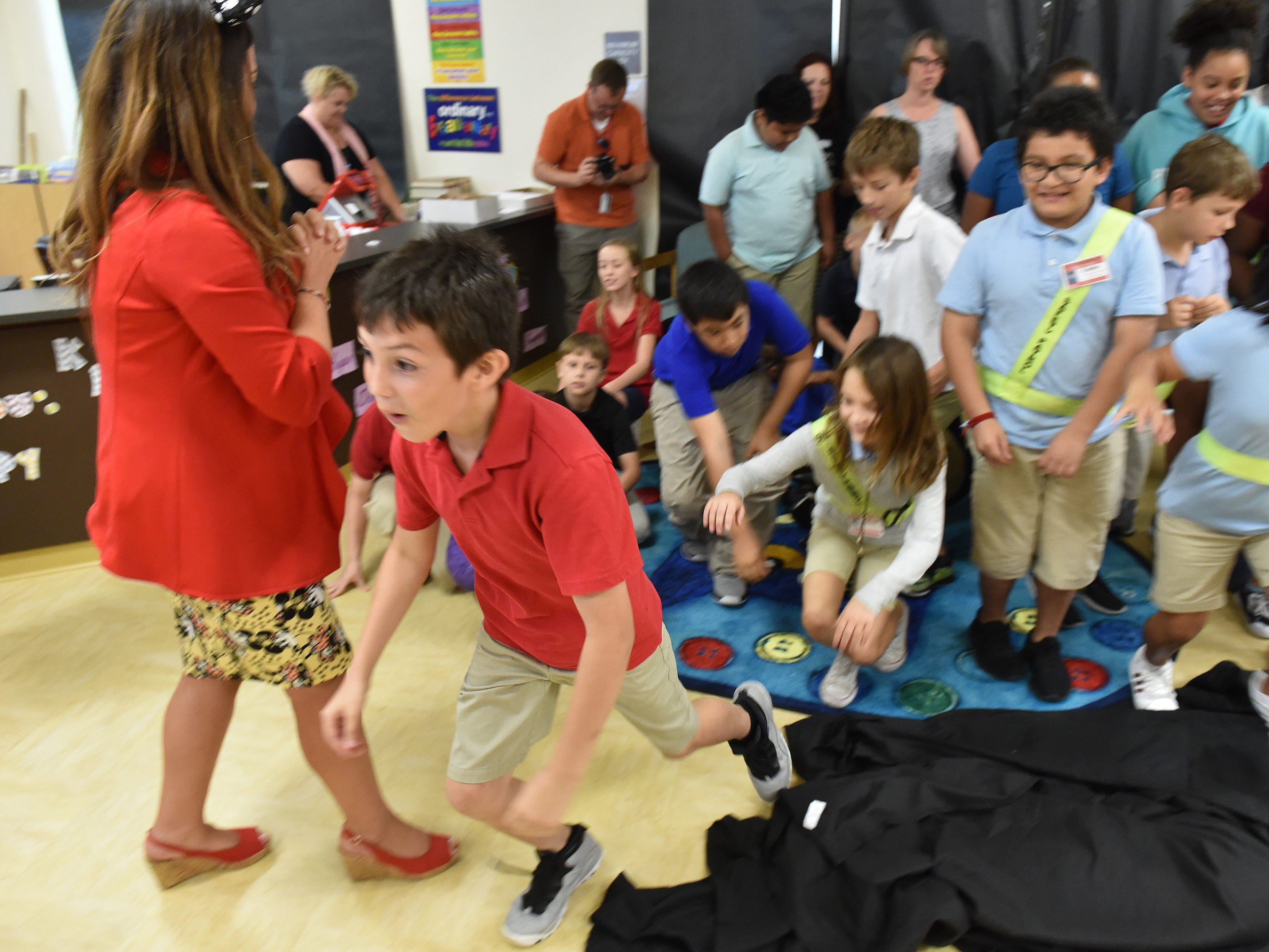 Students at Vero Beach Elementary get a surprise of a lifetime, selecting eleven new books of their choice to keep on Monday, Oct. 1, 2018, in the school's media center.