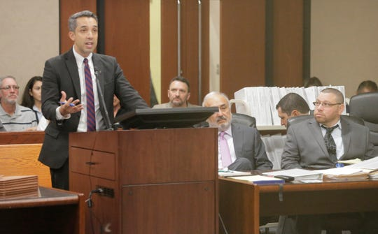 Defense team member Felix Valenzuela addresses 409th District Court Judge Sam Medrano before the beginning of opening statements in the third capital murder trial of Daniel Villegas, right. Looking on center is lead attorney Joe Spencer.
