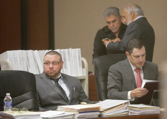 "Daniel Villegas (l) sits with one of his attorneys during opening day testimony in his third trial. Villegas is charged with Capital Murder in connection in the 1993 deaths of Armando ""Mando"" Lazo and Bobby England. Villegas, who was 16 years old at the time, was allegedly a member of a street gang that shot at four teens, fatally striking Lazo and England on April 10, 1993. Lead attorney Joe Spencer stand sin the background with local businessman John Mimbela Sr. who has become a leading voice in the efforts to get Villegas this third trial and released from prison."