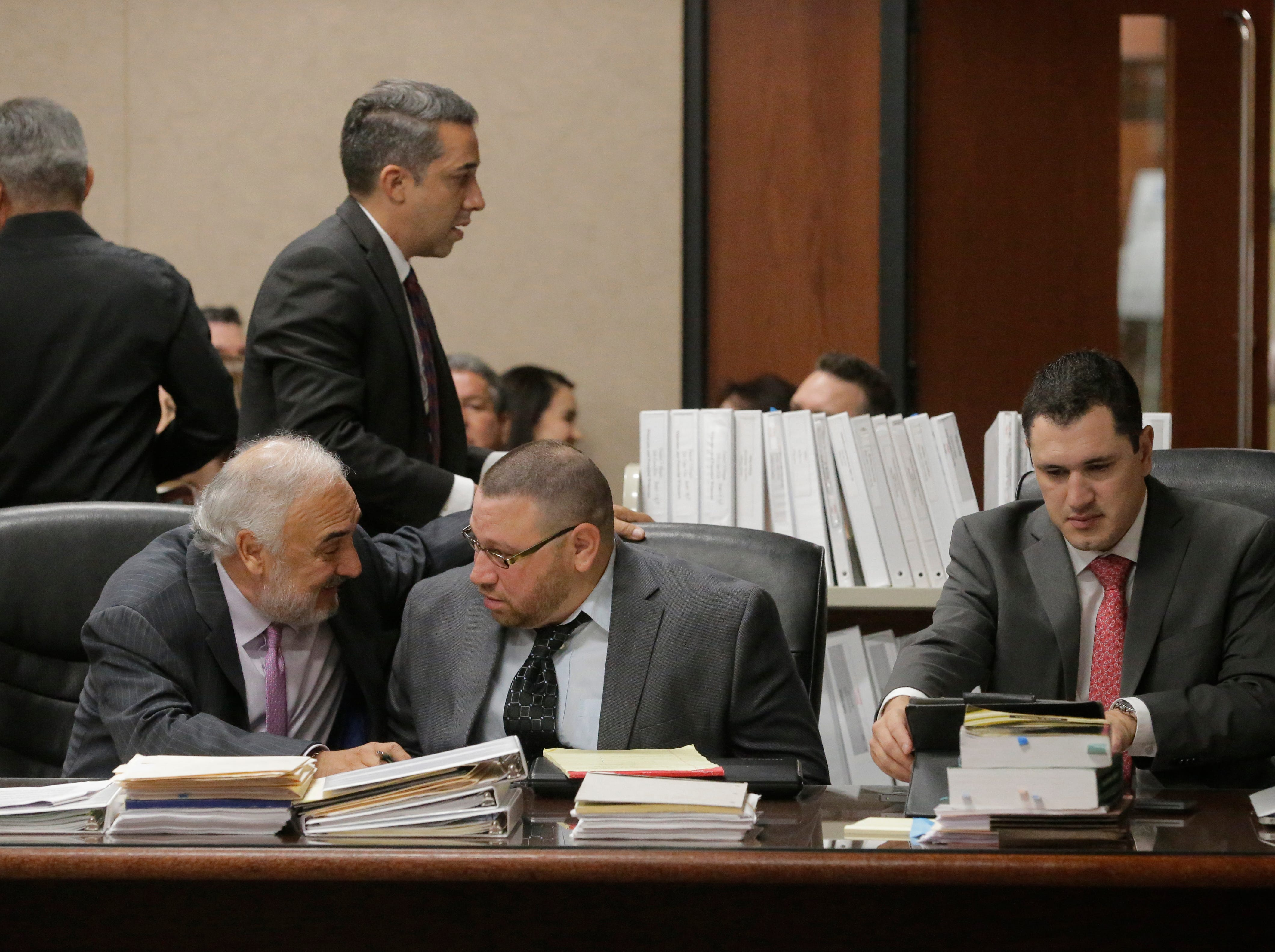 """Attorney Joe Spencer shares a moment with his client Daniel Villegas before opening statements were delivered in the opening day of Villegas' third trial. Villegas is charged with Capital Murder in connection in the 1993 deaths of Armando """"Mando"""" Lazo and Bobby England. Villegas, who was 16 years old at the time, was allegedly a member of a street gang that shot at four teens, fatally striking Lazo and England on April 10, 1993."""