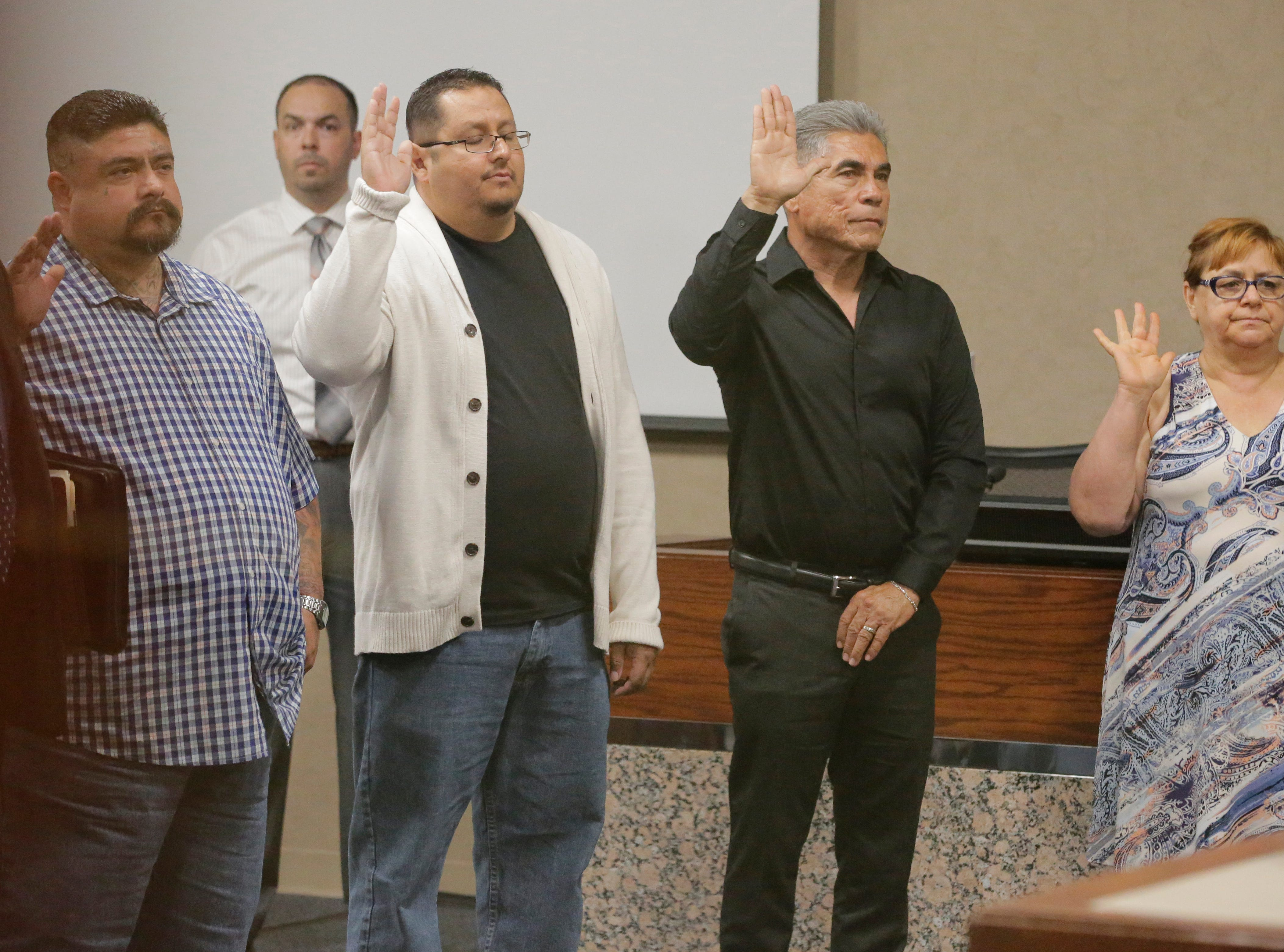"""Some of the witnesses that will be called to testify in the trial of Daniel Villegas stand before 409th District Court Judge Sam Medrano before being sworn in. Villegas is charged with Capital Murder in connection in the 1993 deaths of Armando """"Mando"""" Lazo and Bobby England. Villegas, who was 16 years old at the time, was allegedly a member of a street gang that shot at four teens, fatally striking Lazo and England on April 10, 1993."""
