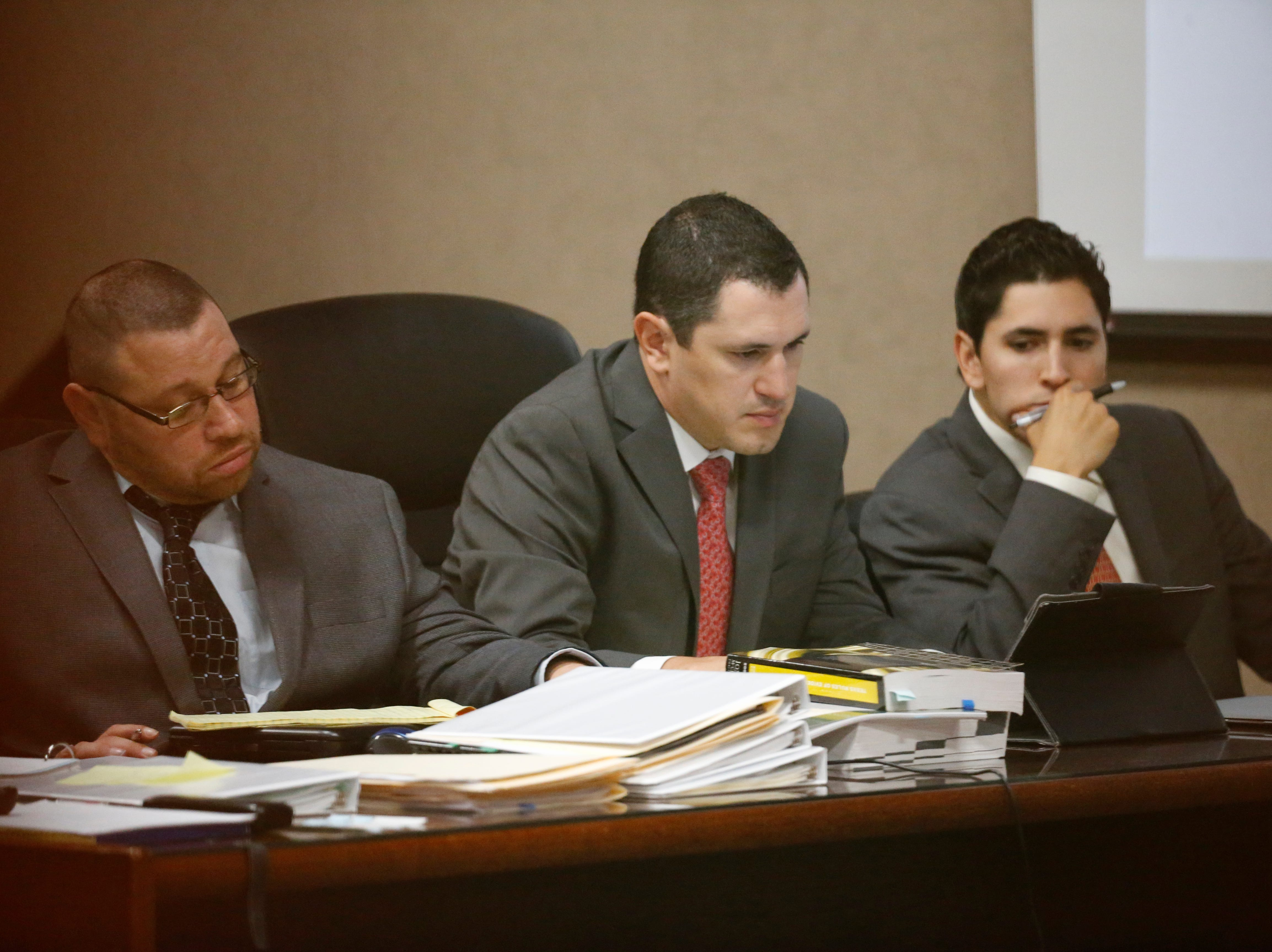 """Daniel Villegas (l) sits with two of his attorneys during opening day testimony in the third trial of El Pasoan Daniel Villegas. Villegas is charged with Capital Murder in connection in the 1993 deaths of Armando """"Mando"""" Lazo and Bobby England. Villegas, who was 16 years old at the time, was allegedly a member of a street gang that shot at four teens, fatally striking Lazo and England on April 10, 1993."""