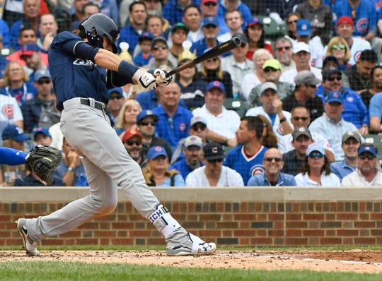 Westlake High graduate Christian Yelich hits an RBI single during the third inning of Monday's tiebreaker game against the Cubs. The Brewers won 3-1 to take the NL Central title.