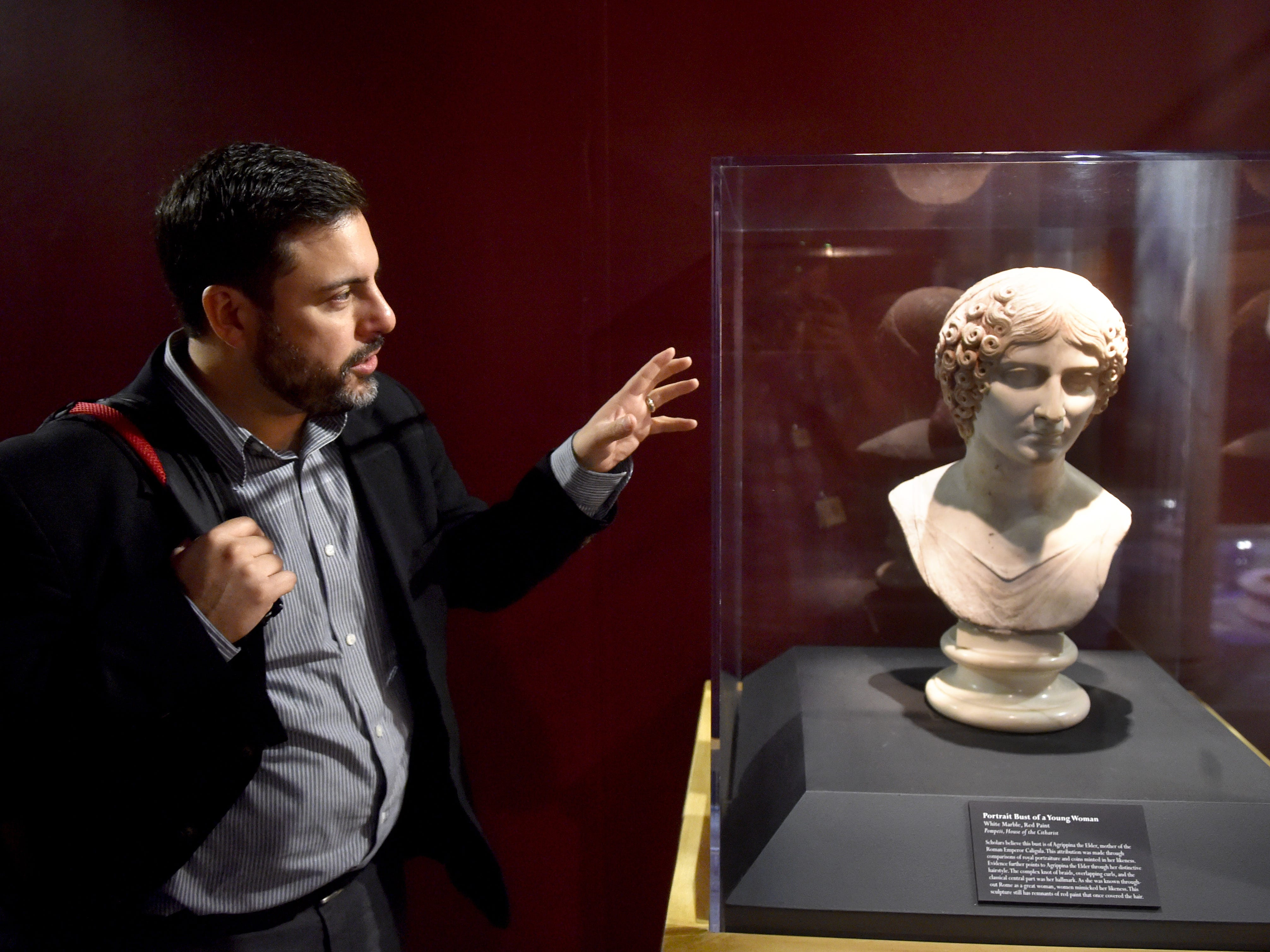 Jason Simmons, of IMG Exhibitions, points out the tinted hair on a marble bust of a young woman, signifying the use of paint during the time the statue was buried by the eruption of Mount Vesuvias approximately 2,000 years ago. The bust is part of the Pompeii exhibit at the Ronald Reagan Presidential Library & Museum in Simi Valley.