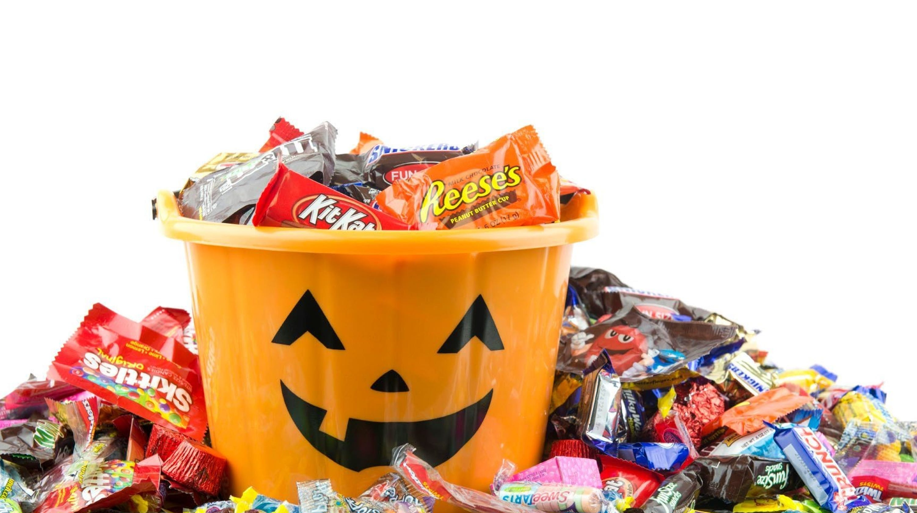 A trick-or-treat basket full of candy