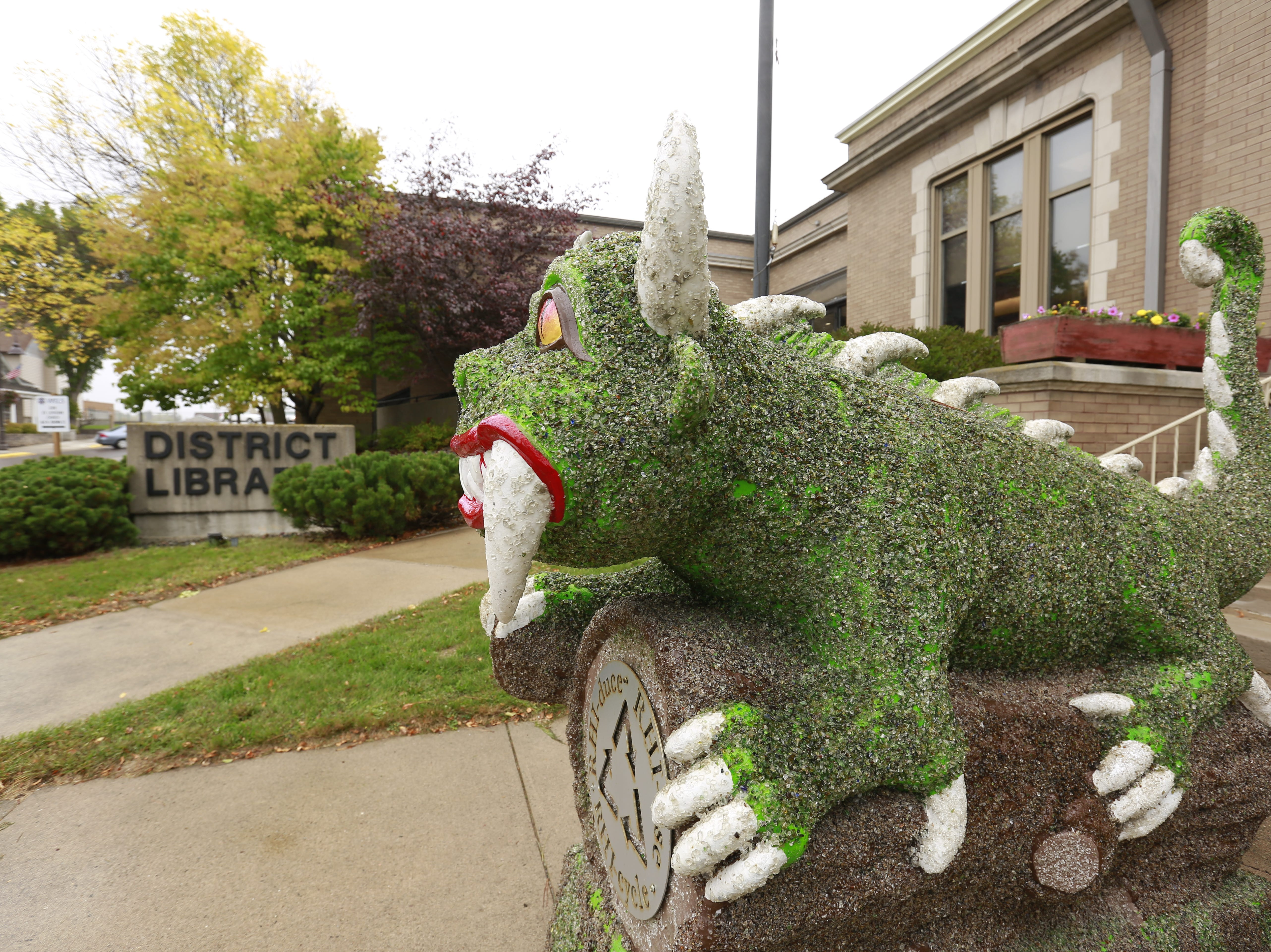 A Hodag sculpture sits on a property of the Rhinelander District Library Tuesday, Sept. 25, 2018, in Rhinelander, Wis.